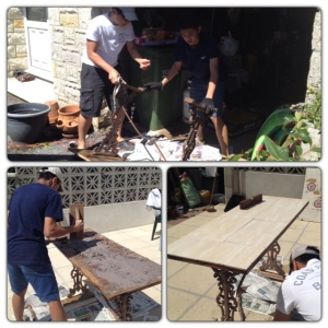 Father and son refurbishing and tiling the old garden table to better weather the elements