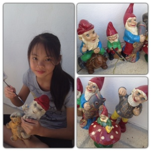Megan giving the gnomes that papa had as a kid a new lease of life with pots of tester paint from B&Q