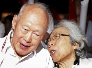 File photo shows Singapore's Minister Mentor Lee and his wife Kwa attending a May Day rally in Singapore